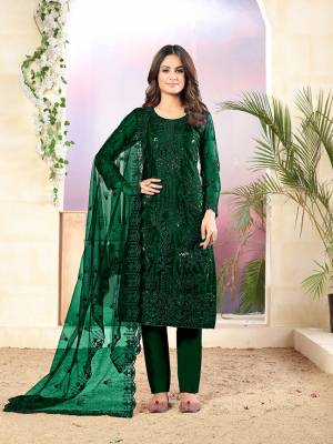 Grab This Very Pretty Designer Straight Suit In Dark Green Color Which Is Suitable For The Upcoming Wedding And Festive Season. Its Top And Dupatta Are Fabricated On Net Beautified With Elegant Tone To Tone Embroidery Paired With Santoon Bottom.