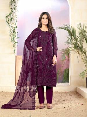 Grab This Very Pretty Designer Straight Suit In Purple Color Which Is Suitable For The Upcoming Wedding And Festive Season. Its Top And Dupatta Are Fabricated On Net Beautified With Elegant Tone To Tone Embroidery Paired With Santoon Bottom.