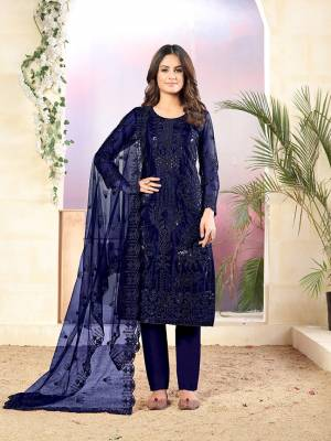 Grab This Very Pretty Designer Straight Suit In Navy Blue Color Which Is Suitable For The Upcoming Wedding And Festive Season. Its Top And Dupatta Are Fabricated On Net Beautified With Elegant Tone To Tone Embroidery Paired With Santoon Bottom.