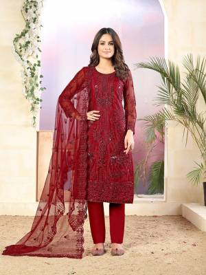 Grab This Very Pretty Designer Straight Suit In Red Color Which Is Suitable For The Upcoming Wedding And Festive Season. Its Top And Dupatta Are Fabricated On Net Beautified With Elegant Tone To Tone Embroidery Paired With Santoon Bottom.