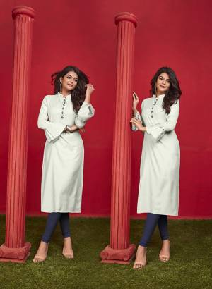 Simple And Elegant Looking Designer Straight Kurti Is Here In Off-White Color Fabricated On Cotton. It Is Beautified With Thread Work And Available In All Regular Sizes. You Can Pair This Up With Leggings Or Pants. Buy Now.