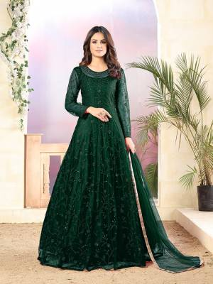 Grab This Very Beautiful Heavy Designer Floor Length Suit In Dark Green Color. Its Top Is Fabricated On Net Paired With Santoon Bottom and Net Fabricated Dupatta. It Is Beautified With Tone To Tone Embroidery All Over. Buy Now.