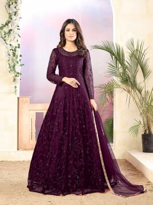 Grab This Very Beautiful Heavy Designer Floor Length Suit In Wine Color. Its Top Is Fabricated On Net Paired With Santoon Bottom and Net Fabricated Dupatta. It Is Beautified With Tone To Tone Embroidery All Over. Buy Now.
