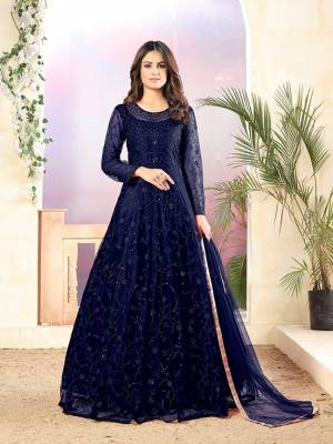 Grab This Very Beautiful Heavy Designer Floor Length Suit In Navy Blue Color. Its Top Is Fabricated On Net Paired With Santoon Bottom and Net Fabricated Dupatta. It Is Beautified With Tone To Tone Embroidery All Over. Buy Now.