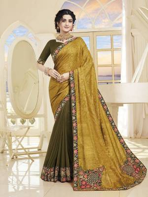 Add This Very Beautiful Designer Saree To Your Wardrobe In Yellow and Olive Green Color. This Saree and Blouse Are Silk Based Beautified With Embroidery. It Is Suitable For The Upcoming Wedding And Festive Season.