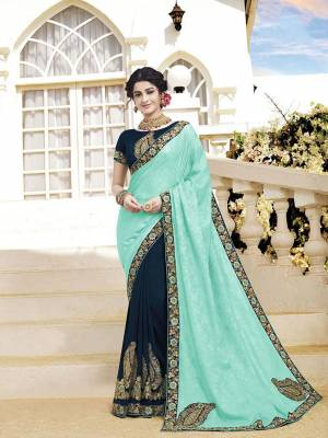 Look Attractive Wearing This Pretty Saree In Aqua Blue And Navy Blue Color. This Saree and Blouse Are Silk Based Beautified With Detailed Heavy Embroidery Giving An Attractive Look.
