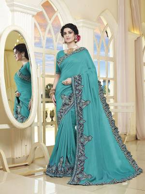 Look Attractive Wearing This Pretty Saree In Blue Color. This Saree and Blouse Are Silk Based Beautified With Detailed Heavy Embroidery Giving An Attractive Look.