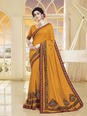 Add This Very Beautiful Designer Saree To Your Wardrobe In Musturd Yellow Color. This Saree and Blouse Are Silk Based Beautified With Embroidery. It Is Suitable For The Upcoming Wedding And Festive Season.