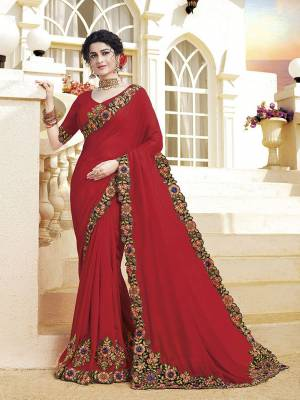 Look Attractive Wearing This Pretty Saree In Red Color. This Saree and Blouse Are Silk Based Beautified With Detailed Heavy Embroidery Giving An Attractive Look.