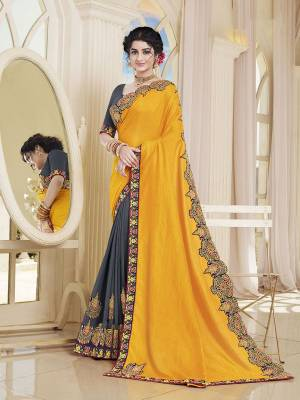 Add This Very Beautiful Designer Saree To Your Wardrobe In Yellow and Grey Color. This Saree and Blouse Are Silk Based Beautified With Embroidery. It Is Suitable For The Upcoming Wedding And Festive Season.