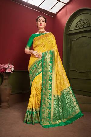 Adorn A Royal Traditional Look Wearing This Designer Silk Based saree In Yellow And Green color. This Saree IS Fabricated On Banarasi Art Silk Paired With Art Silk Fabricated blouse. It Is Beautified With Rich Weave All Over.