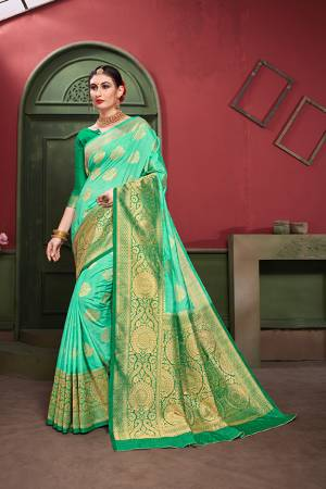 Adorn A Royal Traditional Look Wearing This Designer Silk Based saree In Sea Green And Green color. This Saree IS Fabricated On Banarasi Art Silk Paired With Art Silk Fabricated blouse. It Is Beautified With Rich Weave All Over.