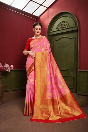 Adorn A Royal Traditional Look Wearing This Designer Silk Based saree In Pink And Red color. This Saree IS Fabricated On Banarasi Art Silk Paired With Art Silk Fabricated blouse. It Is Beautified With Rich Weave All Over.