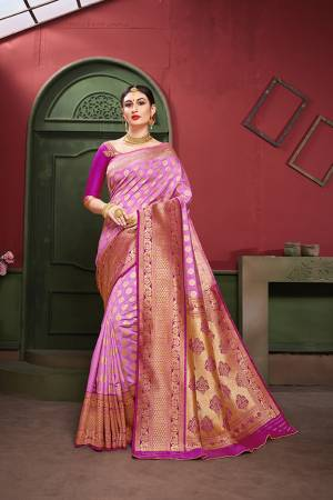 Adorn A Royal Traditional Look Wearing This Designer Silk Based saree In Lilac And Purple color. This Saree IS Fabricated On Banarasi Art Silk Paired With Art Silk Fabricated blouse. It Is Beautified With Rich Weave All Over.