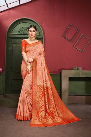 Adorn A Royal Traditional Look Wearing This Designer Silk Based saree In Peach And Orange color. This Saree IS Fabricated On Banarasi Art Silk Paired With Art Silk Fabricated blouse. It Is Beautified With Rich Weave All Over.