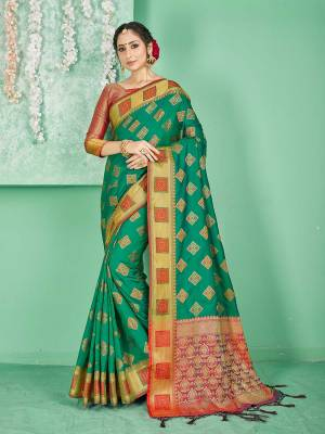 Celebrate This Festive Season Wearing This Saree In Sea Green Color Paired With Contrasting Red Colored Blouse. This Saree And Blouse Are Fabricated On Banarasi Art Silk Beautified With Weave. Buy Now.