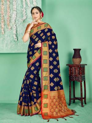 Celebrate This Festive Season Wearing This Saree In Royal Blue Color Paired With Contrasting Red Colored Blouse. This Saree And Blouse Are Fabricated On Banarasi Art Silk Beautified With Weave. Buy Now.