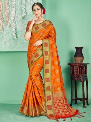 Celebrate This Festive Season Wearing This Saree In Orange Color Paired With Contrasting Red Colored Blouse. This Saree And Blouse Are Fabricated On Banarasi Art Silk Beautified With Weave. Buy Now.