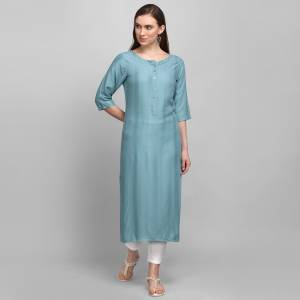Grab This Pretty Simple And Elegant Looking Readymade Straight Kurti In Steel Blue Color. This Pretty Kurti Is Fabricated On Rayon With Self Work And Available In All Regular Sizes.