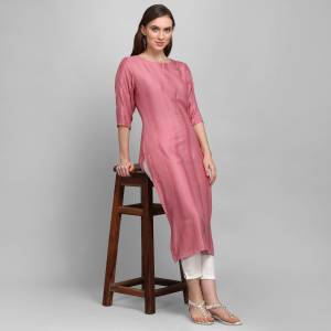 Grab This Pretty Simple And Elegant Looking Readymade Straight Kurti In Dusty Pink Color. This Pretty Kurti Is Fabricated On Rayon With Self Work And Available In All Regular Sizes.