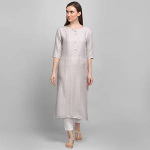 Grab This Pretty Simple And Elegant Looking Readymade Straight Kurti In Light Grey Color. This Pretty Kurti Is Fabricated On Rayon With Self Work And Available In All Regular Sizes.
