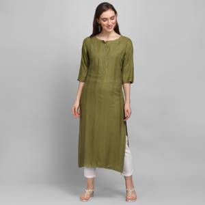 Grab This Pretty Simple And Elegant Looking Readymade Straight Kurti In Olive Green Color. This Pretty Kurti Is Fabricated On Rayon With Self Work And Available In All Regular Sizes.