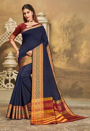 For A Decent And Formal Look, Grab This Pretty Elegant Looking Saree In Navy Blue Color Paired With Contrasting Maroon Colored Blouse. This Saree And Blouse Are Fabricated On Khadi Silk Beautified With Broad Weaved Border.