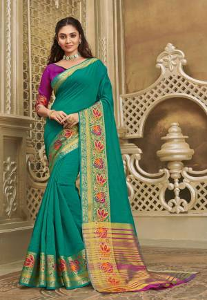 Here IS A Pretty Elegant Looking Saree In Sea Green Color Paired With Contrasting Purple Colored Blouse. This Saree And Blouse Are Fabricated On Khadi Silk Which Also Gives A Rich Look To Your Personality.