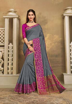 For A Decent And Formal Look, Grab This Pretty Elegant Looking Saree In Grey Color Paired With Contrasting Magenta Pink Colored Blouse. This Saree And Blouse Are Fabricated On Khadi Silk Beautified With Broad Weaved Border.
