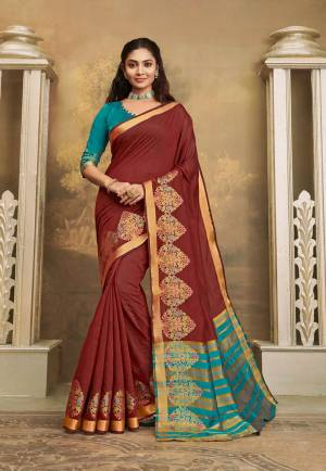Here IS A Pretty Elegant Looking Saree In Brown Color Paired With Contrasting Blue Colored Blouse. This Saree And Blouse Are Fabricated On Khadi Silk Which Also Gives A Rich Look To Your Personality.