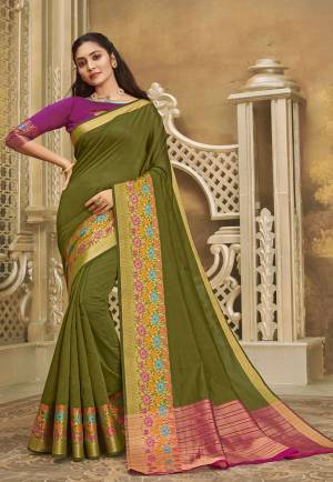 For A Decent And Formal Look, Grab This Pretty Elegant Looking Saree In Olive Green Color Paired With Contrasting Purple Colored Blouse. This Saree And Blouse Are Fabricated On Khadi Silk Beautified With Broad Weaved Border.