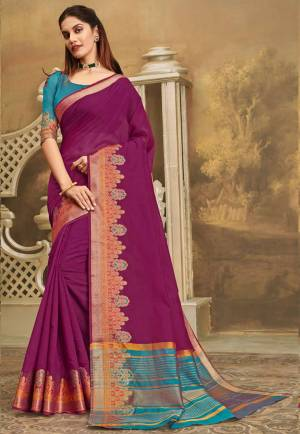 Here IS A Pretty Elegant Looking Saree In Magenta Pink Color Paired With Contrasting Blue Colored Blouse. This Saree And Blouse Are Fabricated On Khadi Silk Which Also Gives A Rich Look To Your Personality.