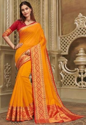 For A Decent And Formal Look, Grab This Pretty Elegant Looking Saree In Orange Color Paired With Contrasting Red Colored Blouse. This Saree And Blouse Are Fabricated On Khadi Silk Beautified With Broad Weaved Border.