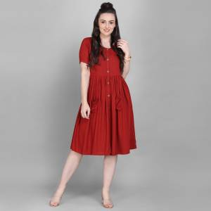 Grab This Super Comfy Readymade Kurti In Red Color Fabricated On Rayon. Its Pretty Tunic Pattern And Fabric Ensures Superb Comfort All Day Long. Buy Now.