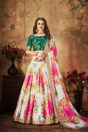 Get Ready For The Upcoming Wedding Season With This Beautiful Designer Lehenga Choli In Pine Green Colored Blouse Paired with Contrasting White And Multi Colored Lehenga And Dupatta. Its Pretty Embroidred Blouse Is Fabricated On Art Silk Paired with Orgenza Fabricated Printed Lehenga and Dupatta.