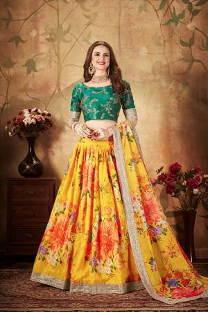 You Will Definitely Earn Lots Of Compliments Wearing This Orgenza Based Designer Lehenga Choli In Pine Green Colored Blouse Paired With Contrasting Yellow Colored Lehenga and Dupatta. Its Blouse Is Silk Based Beautified With Embroidery Paired With Orgenza Fabricated Lehenga And Dupatta Beautified With Prints.