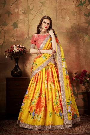Get Ready For The Upcoming Wedding Season With This Beautiful Designer Lehenga Choli In Dark Peach Colored Blouse Paired with Contrasting Yellow Colored Lehenga And Dupatta. Its Pretty Embroidred Blouse Is Fabricated On Art Silk Paired with Orgenza Fabricated Printed Lehenga and Dupatta.