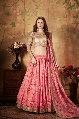 You Will Definitely Earn Lots Of Compliments Wearing This Orgenza Based Designer Lehenga Choli In Beige Colored Blouse Paired With Contrasting Pink Colored Lehenga and Dupatta. Its Blouse Is Orgenza Based Beautified With Embroidery Paired With Orgenza Fabricated Lehenga And Dupatta Beautified With Prints.