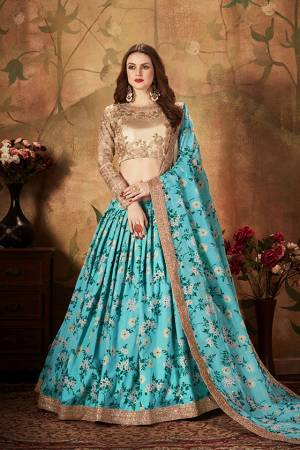 You Will Definitely Earn Lots Of Compliments Wearing This Orgenza Based Designer Lehenga Choli In Beige Colored Blouse Paired With Contrasting Blue Colored Lehenga and Dupatta. Its Blouse Is Orgenza Based Beautified With Embroidery Paired With Orgenza Fabricated Lehenga And Dupatta Beautified With Prints.