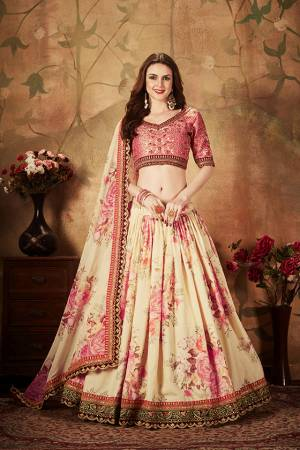 Get Ready For The Upcoming Wedding Season With This Beautiful Designer Lehenga Choli In Pink Colored Blouse Paired with Contrasting Cream Colored Lehenga And Dupatta. Its Pretty Embroidred Blouse Is Fabricated On Art Silk Paired with Orgenza Fabricated Printed Lehenga and Dupatta.