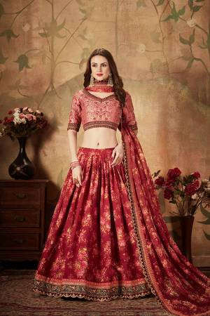 You Will Definitely Earn Lots Of Compliments Wearing This Orgenza Based Designer Lehenga Choli In Pink Colored Blouse Paired With Contrasting Maroon Colored Lehenga and Dupatta. Its Blouse Is Silk Based Beautified With Embroidery Paired With Orgenza Fabricated Lehenga And Dupatta Beautified With Prints.