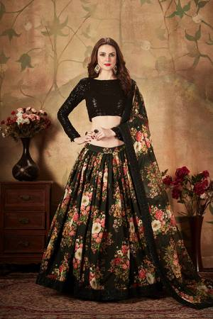Get Ready For The Upcoming Wedding Season With This Beautiful Designer Lehenga Choli In Black Color. Its Pretty Embroidred Blouse Is Fabricated On Georgette Paired with Orgenza Fabricated Printed Lehenga and Dupatta.