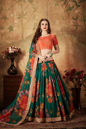 You Will Definitely Earn Lots Of Compliments Wearing This Orgenza Based Designer Lehenga Choli In Orange Colored Blouse Paired With Contrasting Pine Green Colored Lehenga and Dupatta. Its Blouse Is Silk Based Beautified With Embroidery Paired With Orgenza Fabricated Lehenga And Dupatta Beautified With Prints.