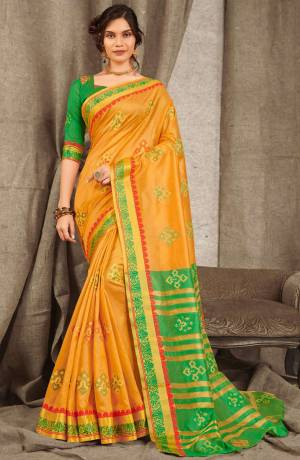 Adorn A Pretty Traditional Look Wearing This Saree In Orange Color Paired With Contrasting Green Colored blouse. This Saree And Blouse Are Fabricated On Cotton Handloom Beautified With Weave All Over.