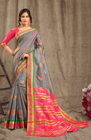Look Beautiful Wearing This Rich Designer Saree In Grey Color Paired With Contrasting Dark Pink Colored Blouse. This Saree And Blouse Are Fabricated On Cotton Handloom Beautified With Weave. Buy Now.