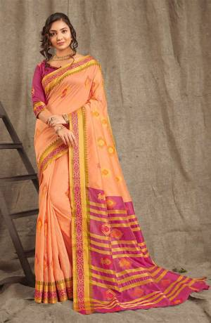 Adorn A Pretty Traditional Look Wearing This Saree In Peach Color Paired With Contrasting Magenta Pink Colored blouse. This Saree And Blouse Are Fabricated On Cotton Handloom Beautified With Weave All Over.