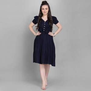 Here Is A Lovely Readymade Western Dress Pattern Readymade Kurti In Navy Blue Color. This Kurti Is Fabricated On Rayon Which Is Soft Towards Skin And Easy To Carry All Day Long.
