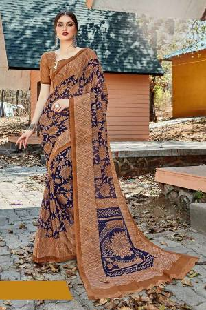For Your Casual Or Semi-Casual Wear, Grab This Printed saree In Brown And Navy Blue Color paired With Brown Colored blouse. This Saree And Blouse Are Fabricated On Georgette Beautified With Prints. It Is Light In Weight And Easy To Carry All Day Long.