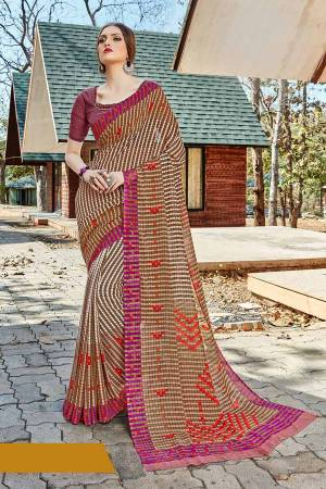 For Your Casual Or Semi-Casual Wear, Grab This Printed saree In Multi Color paired With Purple Colored blouse. This Saree And Blouse Are Fabricated On Georgette Beautified With Prints. It Is Light In Weight And Easy To Carry All Day Long.