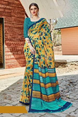 Simple And Elegant Looking Saree Is Here For Daily Wear In Yellow color paired with Blue Colored Blouse. This Saree And Blouse Are Georgette Based Which IS Light Weight And Ensures Superb Comfort All Day Long.